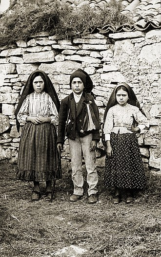 Visions of Jesus and Mary - Lúcia Santos (left) with her cousins Francisco and Jacinta Marto, 1917, were the three shepherds of Fátima.