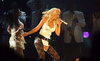 "Back to Basics Tour - Aguilera performing ""Still Dirrty"" in a white bodysuit and black lace thigh-highs"