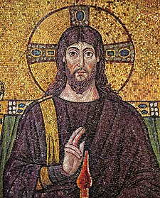 Half-length portrait of younger man with shoulder-length hair and beard, with right hand raised over what appears