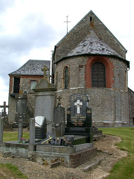 Church and graves in La Flamengrie, a small village in the north of Aisne (France)