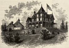 Lithograph depicting a Victorian mansion with gothic turrets on a hill. A large American flag flies over the house.