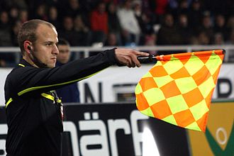 Offside (sport) - Clemens Schüttengruber, referee of Austria; here as assistant referee, showing the position of an offside.