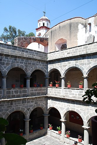 San Miguel Zinacantepec - View of cloister area with bell tower