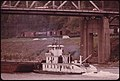 Coal Barge on the Kanawha River near Charleston, West Virginia. Great Amounts of Steam Coal Are Moved on Waterways in the United States Because the Cost Is Cheaper Than Using Other Forms of Transportation 04-1974 (3907196372).jpg