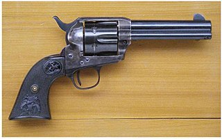 Revolver handgun that has a cylinder containing multiple chambers and at least one barrel