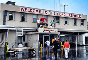 "Conch Republic - The sign ""WELCOME TO THE CONCH REPUBLIC"" greeting those arriving at Key West International Airport."