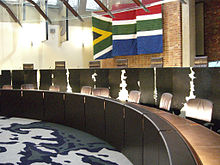 The judges' table in a courtroom of the Constitutional Court of South Africa at Constitution Hill, Braamfontein, Johannesburg.
