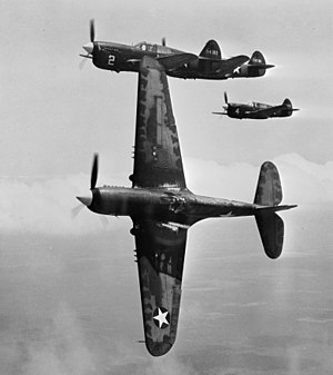 Basic fighter maneuvers - Four P-40 Warhawks performing training maneuvers.