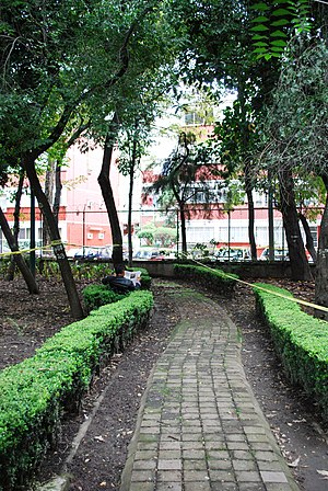 Centro Urbano Benito Juárez - Path in complex area cut off from apartment buildings by a fence