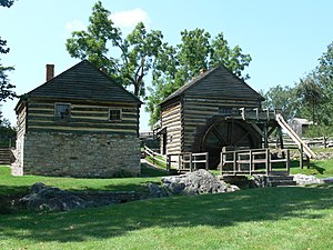 Cyrus McCormick Farm - View from southeast: blacksmith shop at left, grist mill at right. The blacksmith shop was where McCormick built his reaper.
