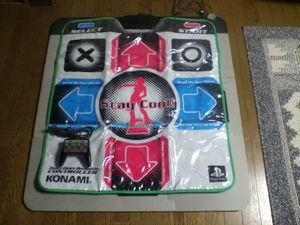 Dance pad - Dance platform for PlayStation version of DDR, with a hand controller in the lower left square for scale