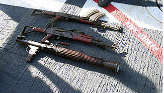 Type 56 assault rifle - A pair of Type 56-2 rifles and a Type 69 RPG.