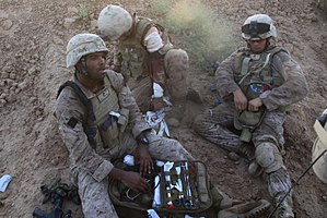 Scalable Plate Carrier - U.S. Navy corpsmen in August 2009 treating a wounded U.S. Marine while wearing the Scalable Plate Carrier.