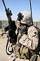 Defense.gov News Photo 101101-M-6340O-075 - U.S. Marine Corps Sgt. Chris Bustamante with Police Adviser Team 1 3rd Battalion 5th Marine Regiment Regimental Combat Team 2 communicates.jpg