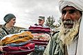 Defense.gov News Photo 110202-N-2142H-001 - U.S. forces help distribute blankets coats wool caps and scarves to local village elders in Shindand in Afghanistan s Herat province on Feb. 2.jpg
