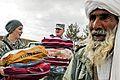 Defense.gov News Photo 110202-N-2142H-001 - U.S. forces help distribute blankets coats wool caps and scarves to local village elders in Shindand in Afghanistan s Herat province on Feb. 2.jpg