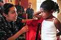 Defense.gov News Photo 110520-N-QD416-443 - U.S. Navy Seaman Arianna Loaiza helps a student put on a donated backpack during a Continuing Promise 2011 community service event in Santa Rosa.jpg