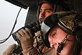 Defense.gov News Photo 110915-M-UC900-515 - U. S. Marine Corps Sgt. Arturo Fernandez left and Gunnery Sgt. Russell J. Hufsey look to the horizon from their UH-1Y Huey while providing.jpg