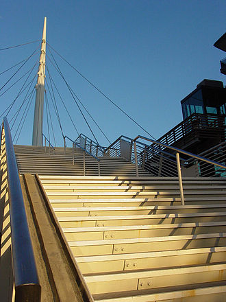 Denver Millennium Bridge - Stairs and a glass elevator lead pedestrians to the landing of Denver's Millennium Bridge.