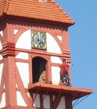 Eschwege - The Dietemann, symbol of Eschwege, blows his horn on the hour after emerging from the Eschweger Schloss Tower.