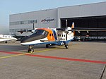 Dornier-228-212-vliegtuig-voor-de-hangar.jpg