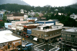 View from a cruise ship of downtown Ketchikan in May 2002. In the foreground is the intersection of Dock and Front streets. The Tongass Trading Company, which anchors the intersection, has operated in Ketchikan since 1898.