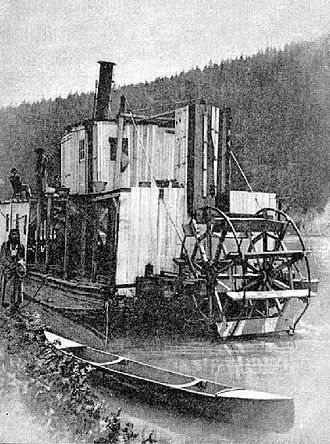 Steamboats of the upper Columbia and Kootenay Rivers - Duchess, steamboat, near Golden, BC ca. 1886.  This is the best-known photograph of this unique vessel.  A member of the First Nations is also shown near the steamer.