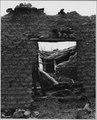 El Cerrito, San Miguel County, New Mexico. Part of a very old wall made entirely of adobe. The bri . . . - NARA - 521162.tif