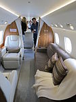 Embraer Legacy 650 interior of aft cabin with passengers.JPG