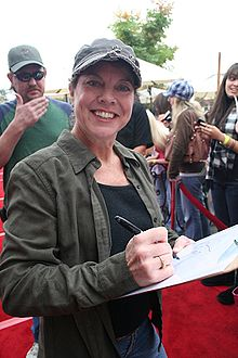 Erin Moran signs autographs on the red carpet at the 62nd Annual Mother Goose Parade in San Diego County.