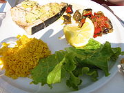 Swordfish in olive oil with ratatouille and saffron rice