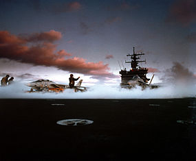 An F-14 and F/A-18 prepare to launch from USS Enterprise (CVN-65), 1985.