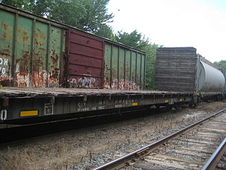 Flatcar - Worn ICE stakesided bulkhead flatcar in the RBMN Duryea yard in July 2012