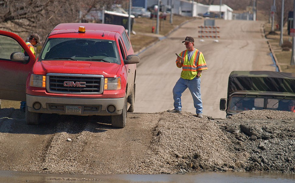 FEMA - 40729 - City engineer checking a clay dike, Sheyenne River, Valley City, North Dakota