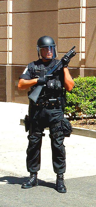 Federal Protective Service (United States) - A U.S. Federal Protective Service officer in the early 2000s, equipped with full tactical gear and a shotgun
