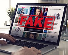 Fake News - Computer Screen Reading Fake News.jpg