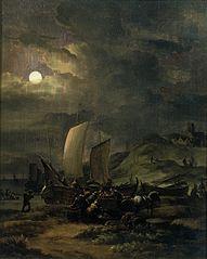 Plage avec des bateaux de pêche de nuit
