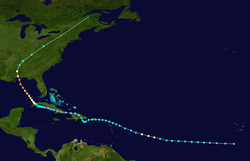 Map showing the path of a storm as represented by colored dots connected by a white line; the position of the dots indicates the storm's position at six-hour intervals, while color denotes the storm's intensity at that point.