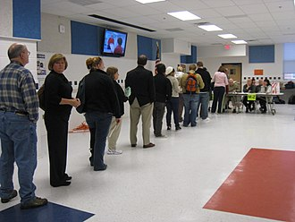 2008 United States presidential election in Virginia - Voters wait in queue at a polling station on the campus of George Mason University