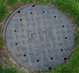 GTE - A manhole cover featuring the company logo in Hillsboro, Oregon