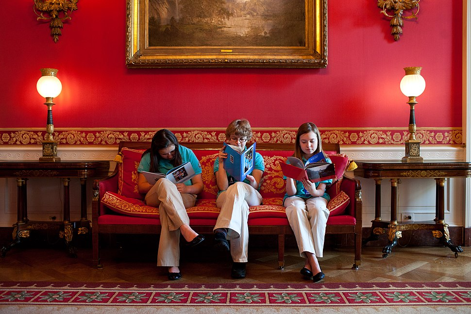 Gaby Dempsey, 12, Kate Murray, 13, and Mackenzie Grewell, 13, read in the Red Room of the White House, 2012