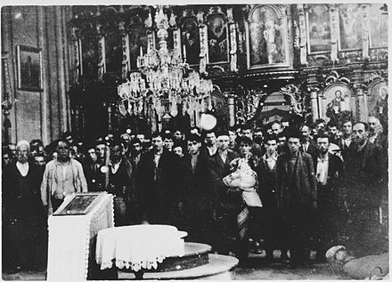 Group of Serb civilians forcibly converted at a church in Glina, after which their throats were slit or heads bashed in, as part of a massacre campaign in the area. Glina church massacre.jpg