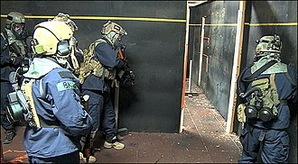 Close quarters combat - FBI HRT (Hostage Rescue Team) operators prepare to storm a room during CQC exercises.