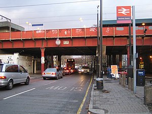 A104 road (England) - A104 Dalston Lane railway bridge Old and new style height warning signs can be seen on the bridge which carries the railway through Hackney Downs station over the A104 Dalston Lane.
