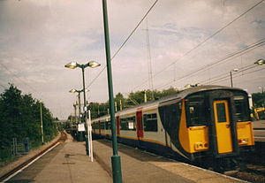 Harlow Town railway station - A WAGN EMU travelling through Harlow Town station in 2001