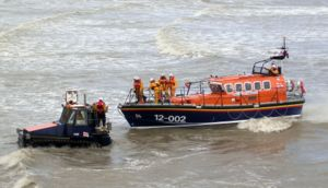 Hastings lifeboat being towed back to beach by its tractor after a public demonstration run during Old Town Week, 2005
