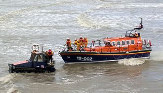 Hastings Old Town - Hastings lifeboat being towed back to beach by its tractor after a public demonstration run during Old Town Week, 2005