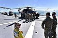 Helicopters and personnel on the flight deck of HMAS Canberra June 2018.jpg