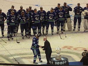 NHL Conference Finals - Henrik Sedin of the 2011 Western Conference champion Vancouver Canucks accepts the Campbell Bowl