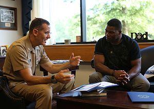 Herschel Walker - Herschel Walker talks with Navy Capt. David Lane.
